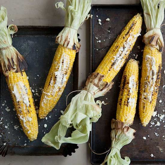 Summer isn't SUMMER without corn on the cob, @sarahecrowder says. Sure, you can enjoy grilled corn, but you can also try these twists on the vegetable side dish that call for flavored butters, chimichurri, and even a batter-fried corn dog-like corn on the cob recipe.