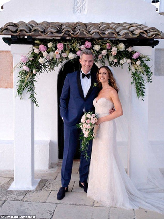 The happy couple:Million Dollar Listing's Ryan Serhant shared a wedding photo with new wife Emilia Bechrakis after saying 'I do' in Greece on Thursday. She wore a strapless gown and he had on a blue suit