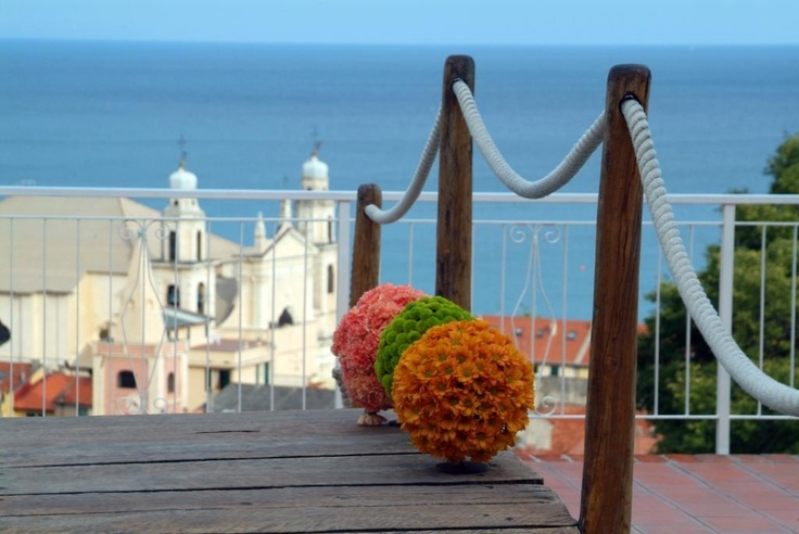 The old Town of Pietra Ligure and Mediterranean sea from the wodden-bridge of our pool