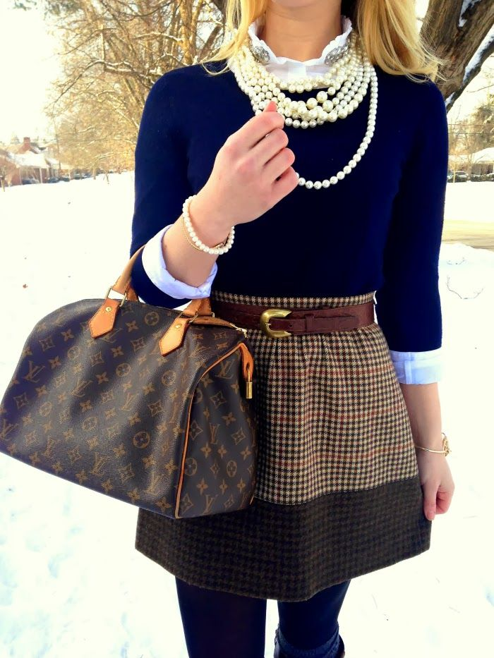 layered pearls, jeweled collar, navy pullover, and J.Crew herringbone skirt...I have this skirt...love it styled here!