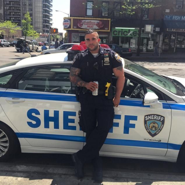 A photo of New York City Sheriff's Deputy Miguel Pimentel leaning against a squad car has left internet users begging to be taken into custody.