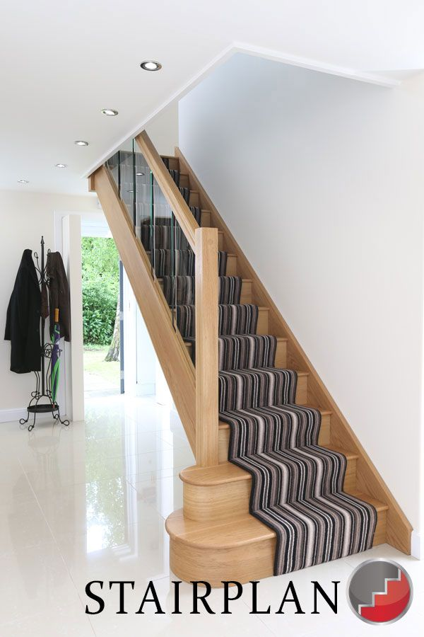 Houston Oak Staircase with glass balustrade striped carpet runner