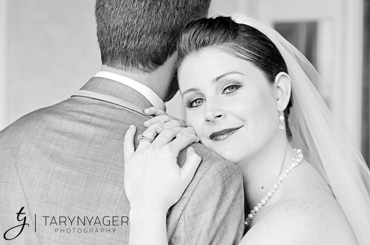 I have a photo like this one, you can even see the groomsmen walking away in the background! Loveit!!