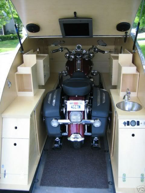 The ultimate teardrop trailer... a teardrop toy hauler. Roll out the bike, put a bed in there. Yeah, baby!
