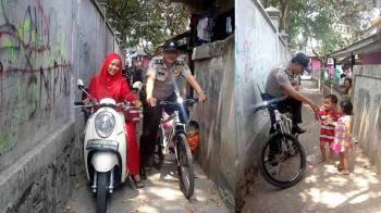 Patroli Pakai Sepeda, Aiptu Kasim Sambangi Anak-Anak dan Masyarakat