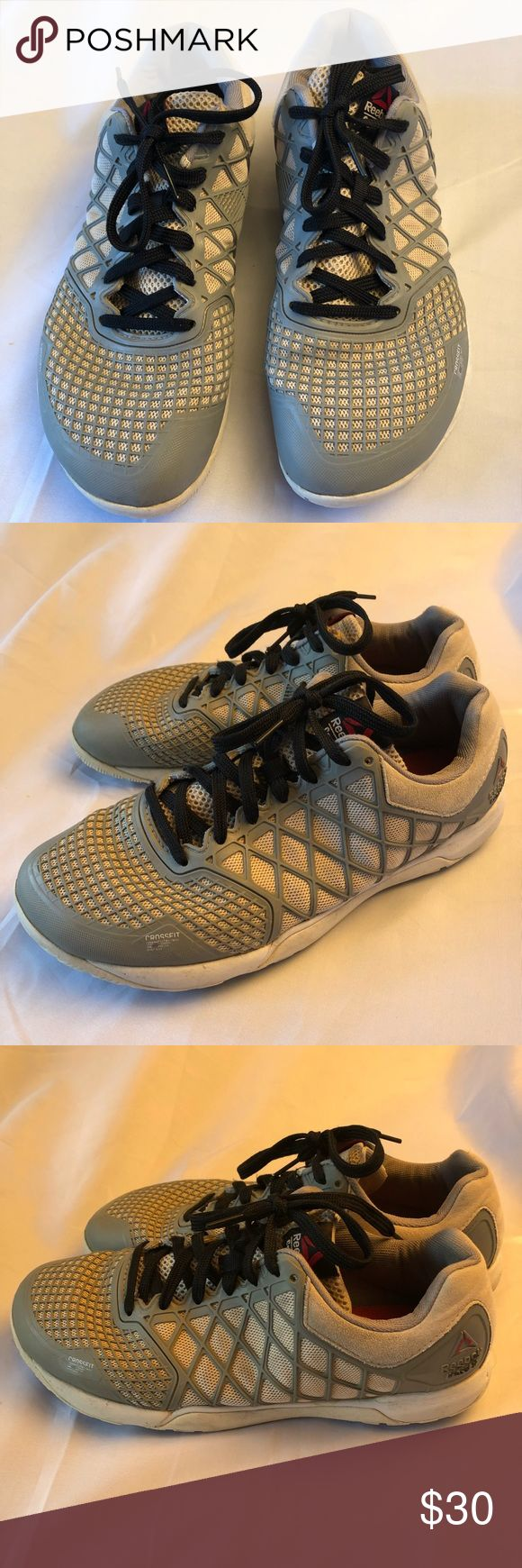 Men's REEBOK CrossFit 10.5 men's REEBOK CrossFit  10.5 in used confusion. Some slight wear around edge near the tongue on right shoe. Price reflects condition. Reebok Shoes Athletic Shoes
