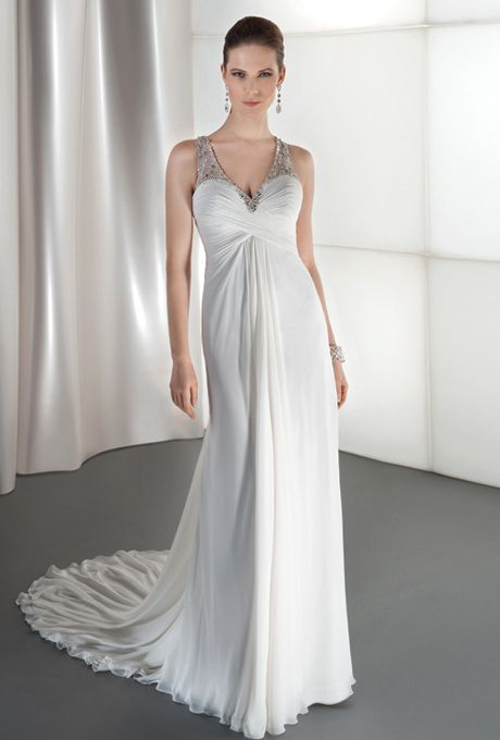 Brides: Demetrios - Destination Romance . Chiffon, sleeveless, A-line with asymmetrical wrapped ruching on bodice and v-neckline. Crystal beading embellishes sheer neckline, and continues throughout unique design on back. Skirt features a draped back and attached train. Available in ivory and white.