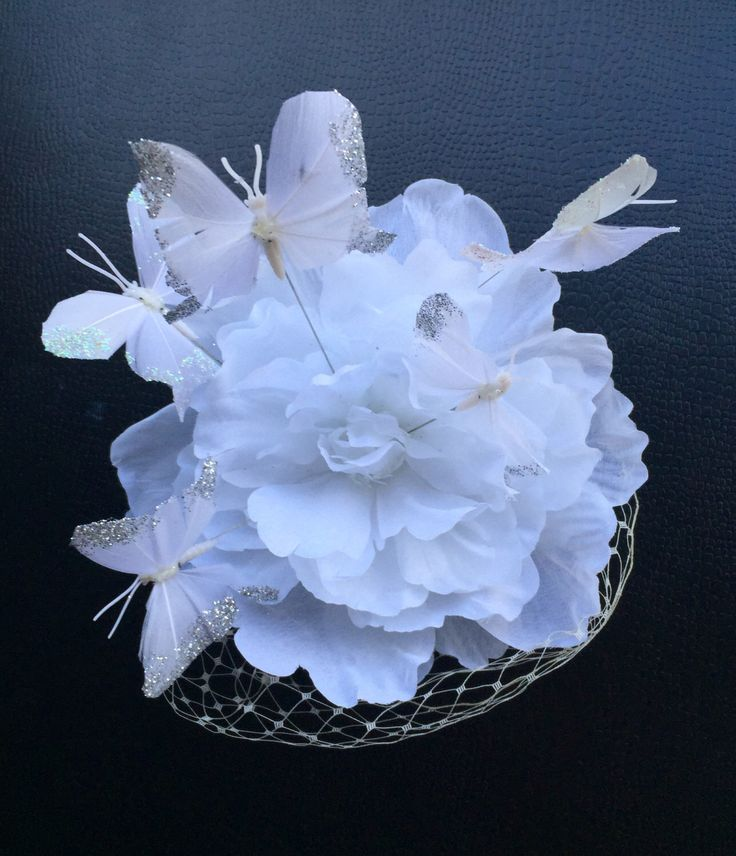 A personal favourite from my Etsy shop https://www.etsy.com/au/listing/250722953/white-flower-and-butterfly-fascinator