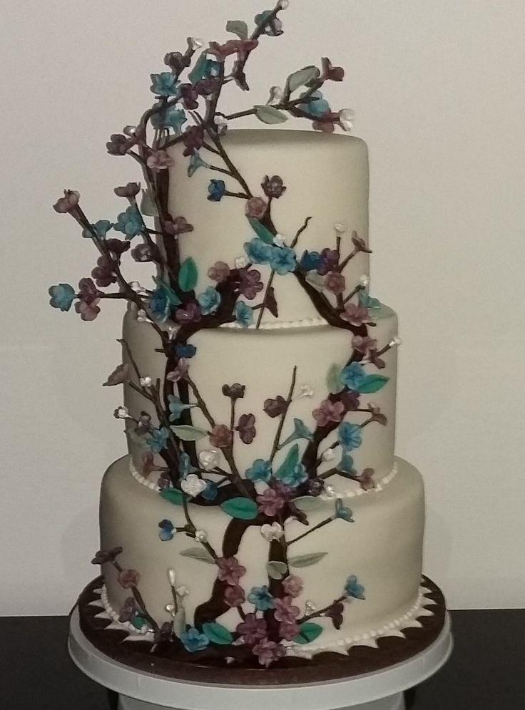 Japanese Style Wedding Cake. Beautiful blend of ivory, blue and purple blossoms to complement the theme.
