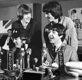 """In August, 1965, a 17-year-old local photographer documented the Beatles' only appearance in Minnesota. Bill Carlson's images include photos of the band's arrival at Wold Chamberlain Field, the mobs of girls waiting to greet them, their press conference and performance at Met Stadium. These and other images were on display at the Minnesota Historical Center in 2010 and were from Carlson's book """"The Beatles: A One-Night Stand in the Heartland""""."""