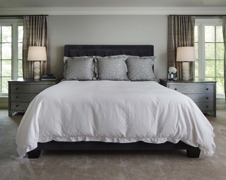 Morgante Wilson Archtiects mixed materials in this Master Bedroom.  The nightstands are hammered metal and the Visual Comfort table lamps are alabaster.  The walls are painted Benjamin Moore Gray Horse.