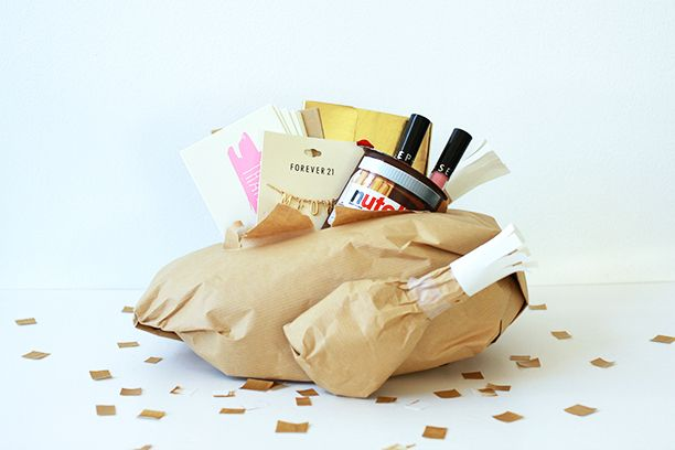If you can't spend Thanksgiving together, send your loved one this DIY paper turkey, filled with yummy surprises.