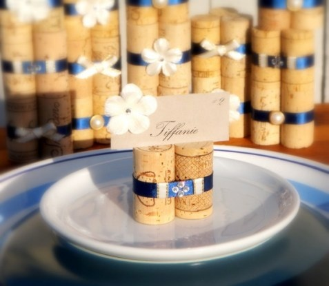wine cork place card holders.....These could also be used for holding photos, menu cards, and table numbers at dinner parties or wedding showers. The possibilities are endless!