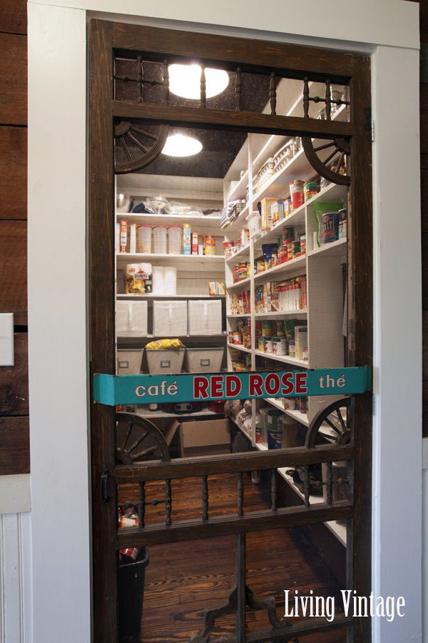Organized walk in pantry - love the old screen door!   If I had a pantry and it was kept near, I would totally do this.