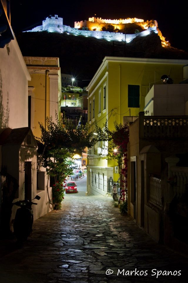 """The village of Platenos, perched up on a hill overlooking Pandeli Bay.   In theory the """"capital"""" of Leros, tho it's roads are still only donkey-wide!  The old fortress still towers above everything on the island, a gorgeously-lit beacon at night.   Leros island, Greece."""