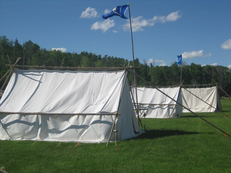 "These  canvas tents housed the numerous students that were taking lessons  for the fiddle, guitar, mandolin and bag pipes. Other available workshops were drum making and moccasin making, at the ""Hills are Alive"" Culture and Music festival, at  Cypress Hills, Alberta, June 2013."