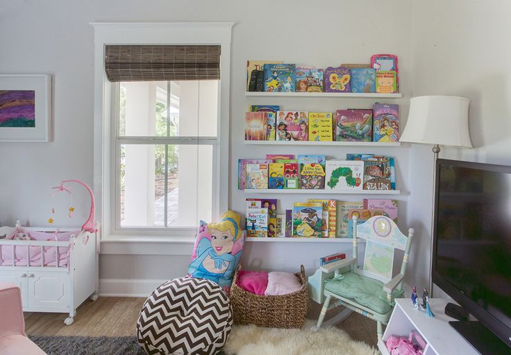 playroom design, playroom ideas, playroom, ikea shelves, floating shelves, shag rug, chalkboard wall, craftsman window trim, book ledge, kid kraft play kitchen, retro play kitchen, pottery barn kids chairs, kids room, interior design, before and after, vero beach interior designer