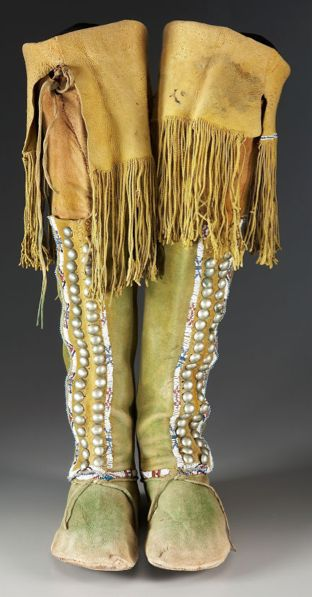 A PAIR OF COMANCHE BEADED HIDE HIGHTOP MOCCASINS. c. 1880