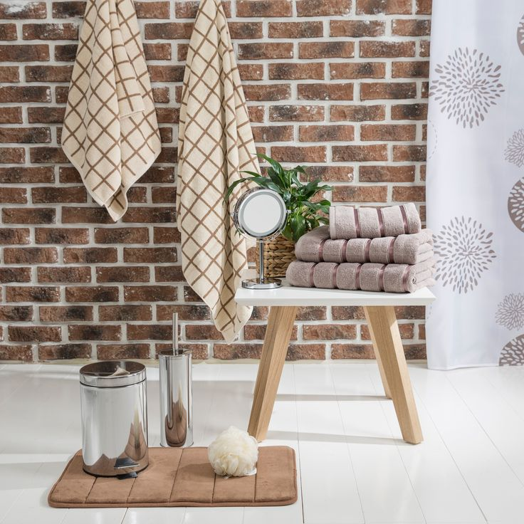 Pick nice earthy coloured towels and accessories for your little bathroom upgrade jysk