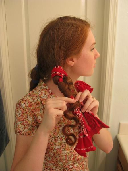 "A new ""twist"" on rag curls.I think this one could comb out to a nice finger wave curled look on long hair. Must try it..."