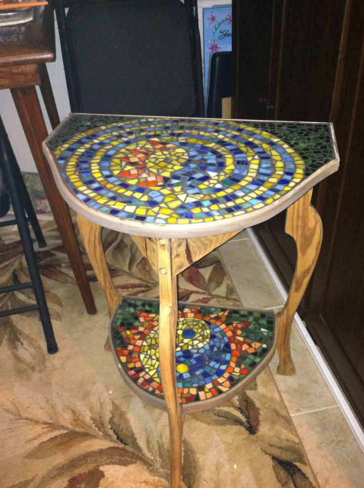 After, Recently I saved this table from the trash and created the mosaic on the top and bottom with stain glass.