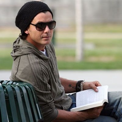 Gavin Rossdale reading at the park