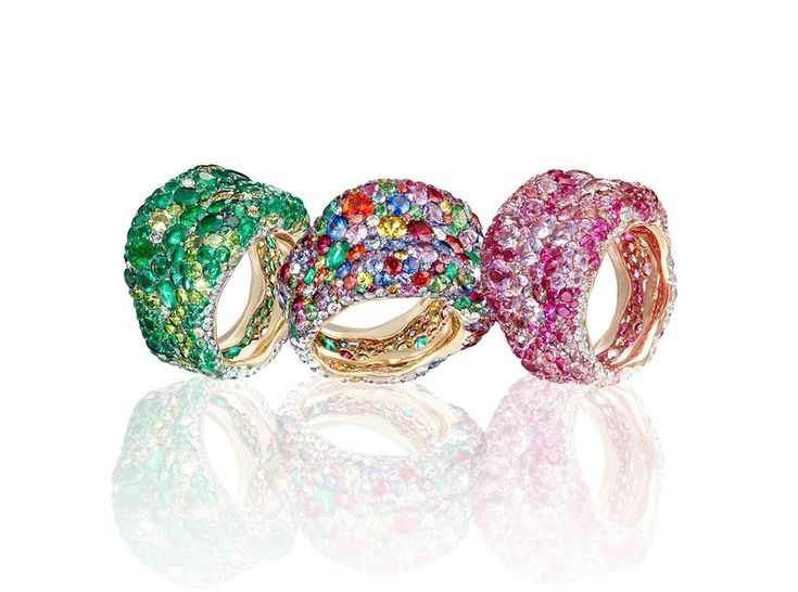 Faberge Emotion rings in a cocktail of colours, pave set with emeralds, pink diamonds, purple sapphires, turquoise Paraiba tourmalines and other coloured gemstones.