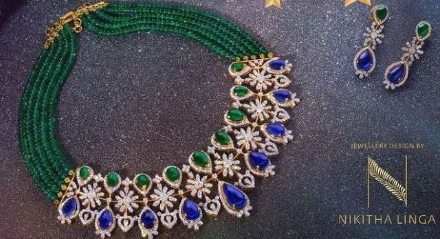 Five Strings emerald beads classic choker with diamond flower motifs placed all over. Pear shaped emeralds and Blue sapphire decorated at the top and bottom by Nikitha Linga.