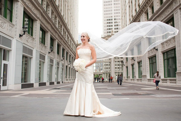 It wouldn't be a Chicago wedding without a windy veil shot! This is a stunning veil ~ here's a close-up shot: http://stylemepretty.com/gallery/picture/577281  LOVE the edging. Photography by sarahpostma.com