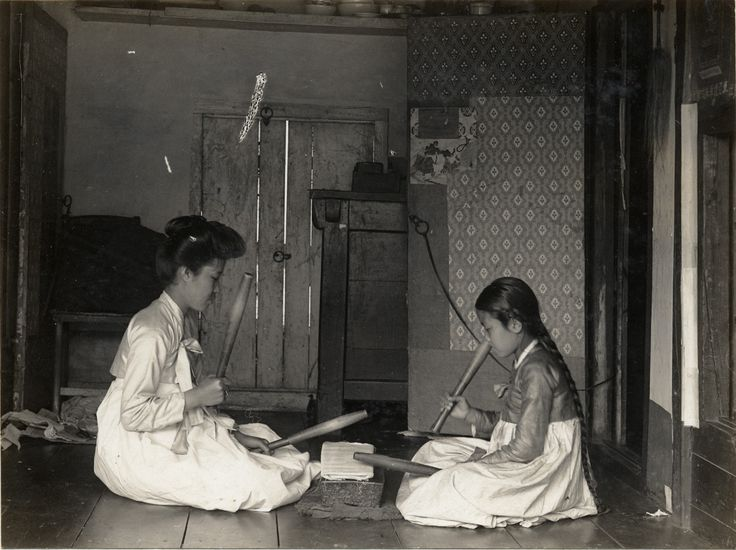 In Korea two women knelt on the floor, facing each other across a smoothing stone or tatumi-tol, a pangmangi club in each hand, beating out a rhythm on the cloth.