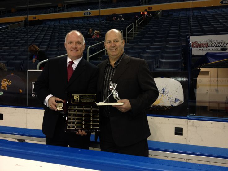 Executive Director Larry Landon presents Claude Julien with the 2013 PHPA Curt Leichner Distinguished Member Award