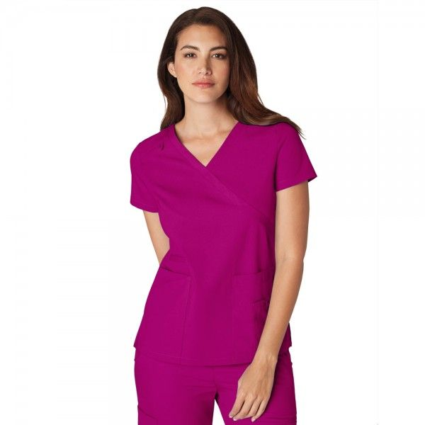 The Coronado scrub top is in the Orange Standard Scrubs Collection range. This scrub top is a very stylish scrub uniform top for all body types. A simplistic banded crossover V-Neck with a tone on tone small loop on the right shoulder for an ID badge. It also features great pocket extras; two very spacious front patch pockets, one with a pen pocket and the other with an additional pocket for smaller accessories.  £19.99  #nursescrubs #dentistuniform #nurses #dentists #nurseuniform