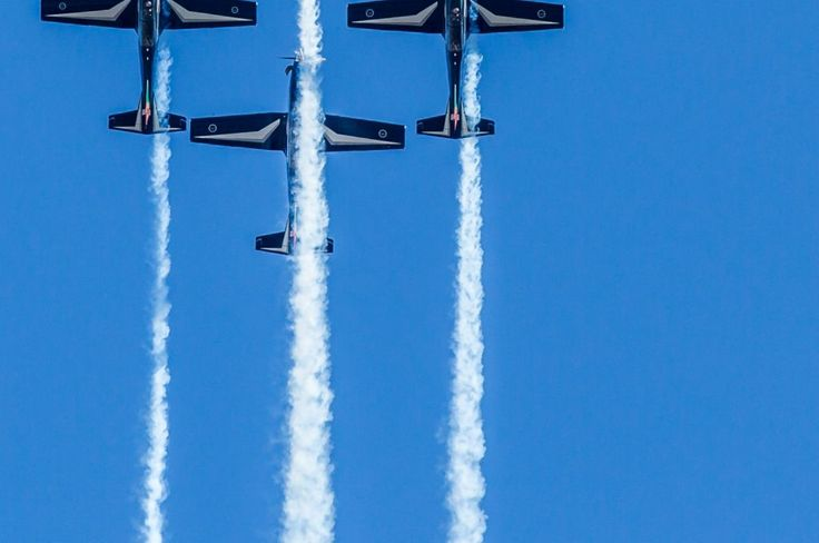 Airshow, Four Planes Flying Vertically Closer Shot