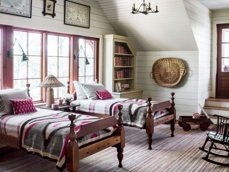Antique-inspired rustic cabin bedroom with twin beds draped in wool Pendleton blankets.
