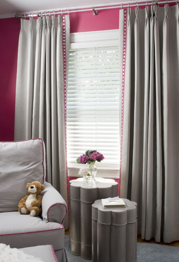 Pink and grey girls room.  Grey curtains with an added touch of pink to help it flow.