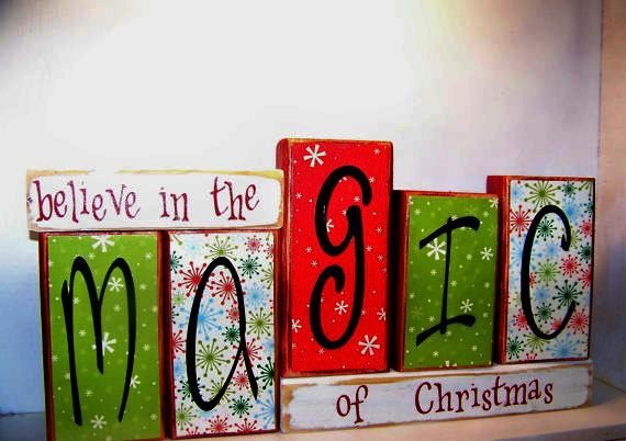 "Primitive wood block Sign saying ""believe in the MAGIC of Christmas"". $28.95, via Etsy."