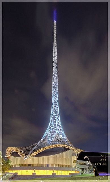 The 162-metre tall steel spire and the wrap-around base of The Victorian Arts Centre at Southgate. Designed by architect Sir Roy Grounds, the centre opened in 1982. The spire is illuminated with 6,600 metres of optic fibre tubing, 150 metres of neon