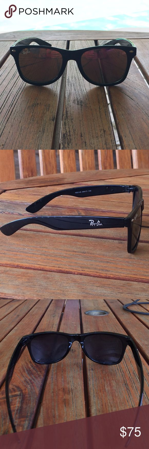 Wayfarer Ray Bans Wayfarer Ray Bans. I'm great condition! They have pinkish lens as you can see in the picture! Originally $140 Ray-Ban Accessories Sunglasses