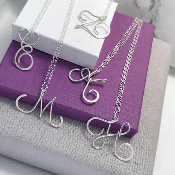 || CHRISTMAS HOLIDAYS || We are now closed until Jan 2nd - Happy Holidays 🎄 This lovely calligraphy silver initial necklace has been handcrafted using Sterling Silver wire which has been hand shaped and hammered for strength and design. ◊ Size of Pendant: Apx 3/4 - 1 long ◊ Packaged in