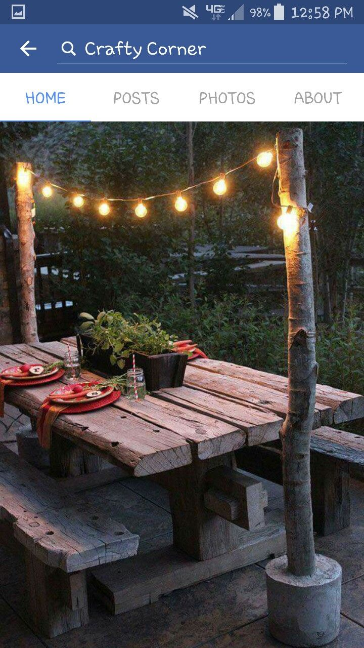 Hang outdoor lights with movable cement weighted posts or branches