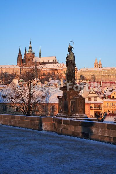 Prague Castle from the Charles Bridge with the statue of Saint John Nepomuk in foreground, Prague, Czech Republic