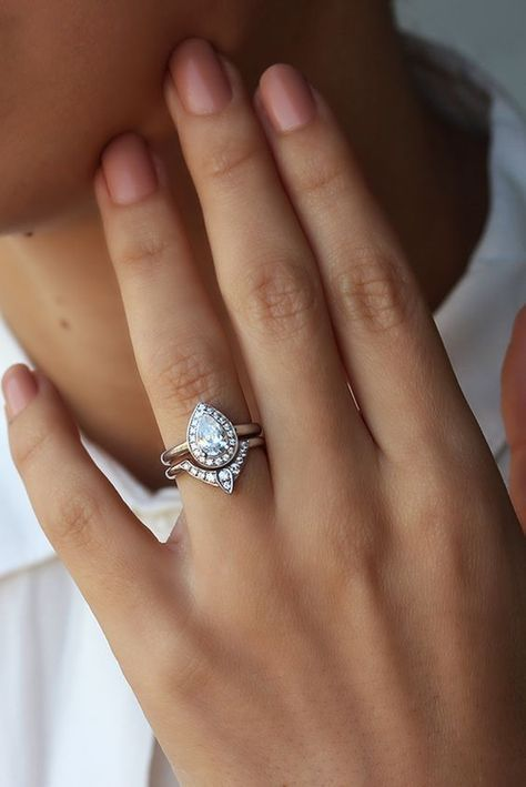This would be perfect if the engagement stone was round. I really like the combo of a classic engagement ring with a more uniquely shaped wedding ring to compliment it.