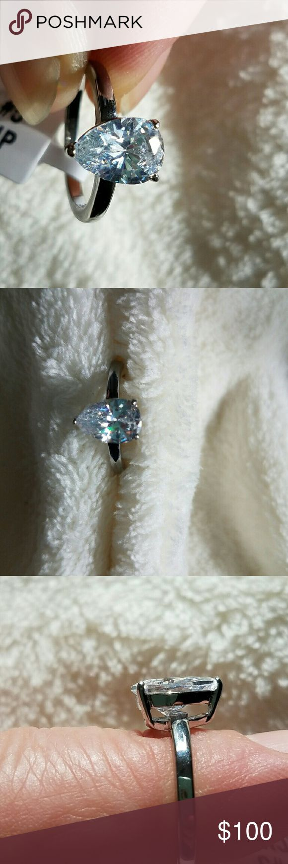 NWT Cz Engagement Ring Size 6 This is an exquisite ring that sparkles brilliantly. A beautiful stainless steel ring with a gorgeous 1.80 karat cz that is 2mm wide. Will not tarnish. Stamped 316. A stunning ring that is cut to look like a real diamond. Jewelry Rings