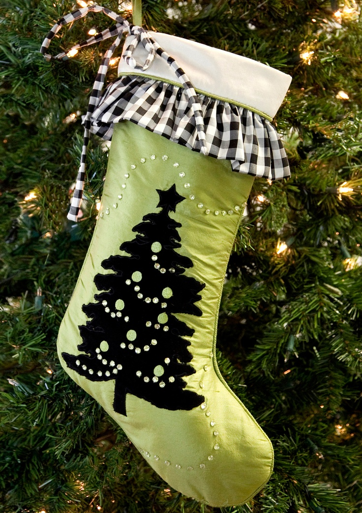 Comes in red or green, and has matching tree skirts!  I like the black and white plaid ruffle around the top with the green Christmas stocking.