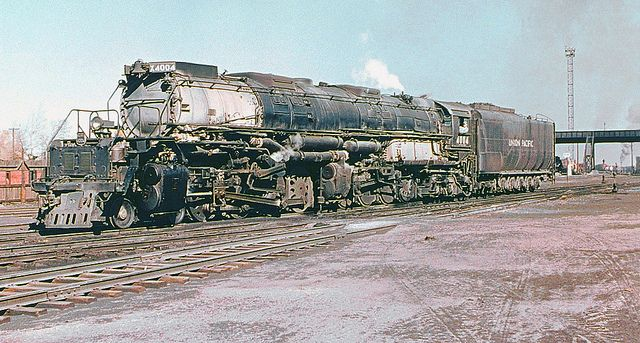 Union Pacific Alco class 1 Big Boy 4-8+8-4 articulated steam locomotive # 4004, is seen in the railroad yard at Laramie, Wyoming, 10-16-1955