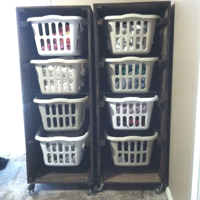 I finally have my laundry basket holders made!!! With a few tweaks of course. Originally saw the idea here on Pinterest @Elizabeth Lockhart Vazquez  original pin. But more importantly for @Ana G.-white.com for instructions! My tweaks 4 baskets high, deeper instead of wider with locking casters!! I am one happy person!!!!!!!