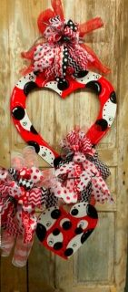 Set Includes Large Valentine Door Hanger with Bow, flag pole heart with side bow.  Does not include flag pole stand.