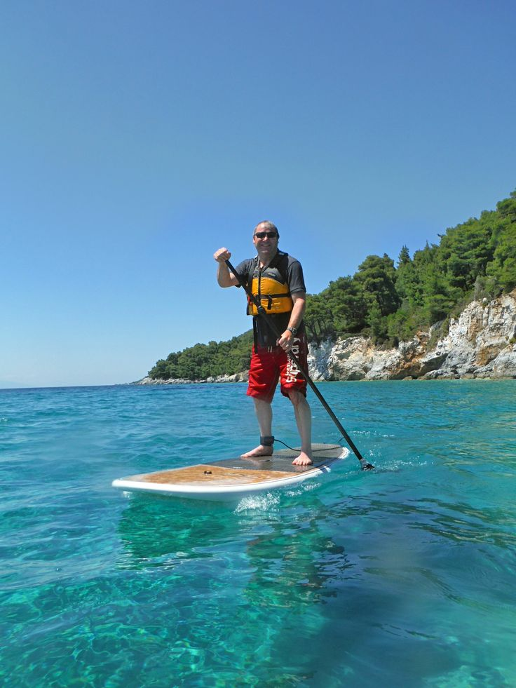 Duncan Johnson taking to the board Yeehaa! With Sporades SUP Skopelos Greece.