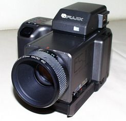 "One of the first digital cameras, the FujiES-1. It was a ""still video"" camera and recorded 640x480px jpegs on a 3.5 in floppy."