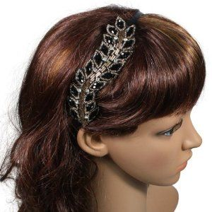 """Greek Style Fashion Black Gold Crystal Leaf 0.25"""" Vintage Style Headband by CHINA PF LLC. $8.99. Measure: Band is 0.25 Inches W x 15 InchesL, Leaf is 1.5 inches W x 5.5 inches L. Stylish headband for young teens and ladies of all ages. Made from High Quality Bead Crystal, Base Metal, and Fabric. Handmade Headband Hair Accessory; Made in India, imported to USA. Fabulous fancy handmade black gold tone headband with beaded crystal leaves on side. Vintage and elegant design..."""